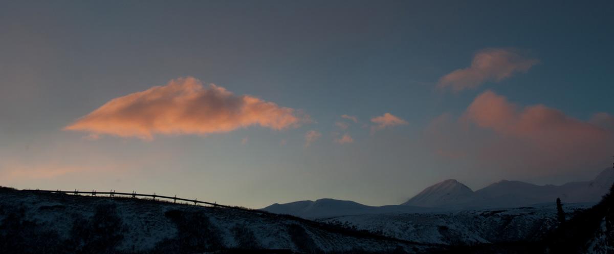 The Trans-Alaska Pipeline in silhouette near Black Rapids Lodge in Interior Alaska.