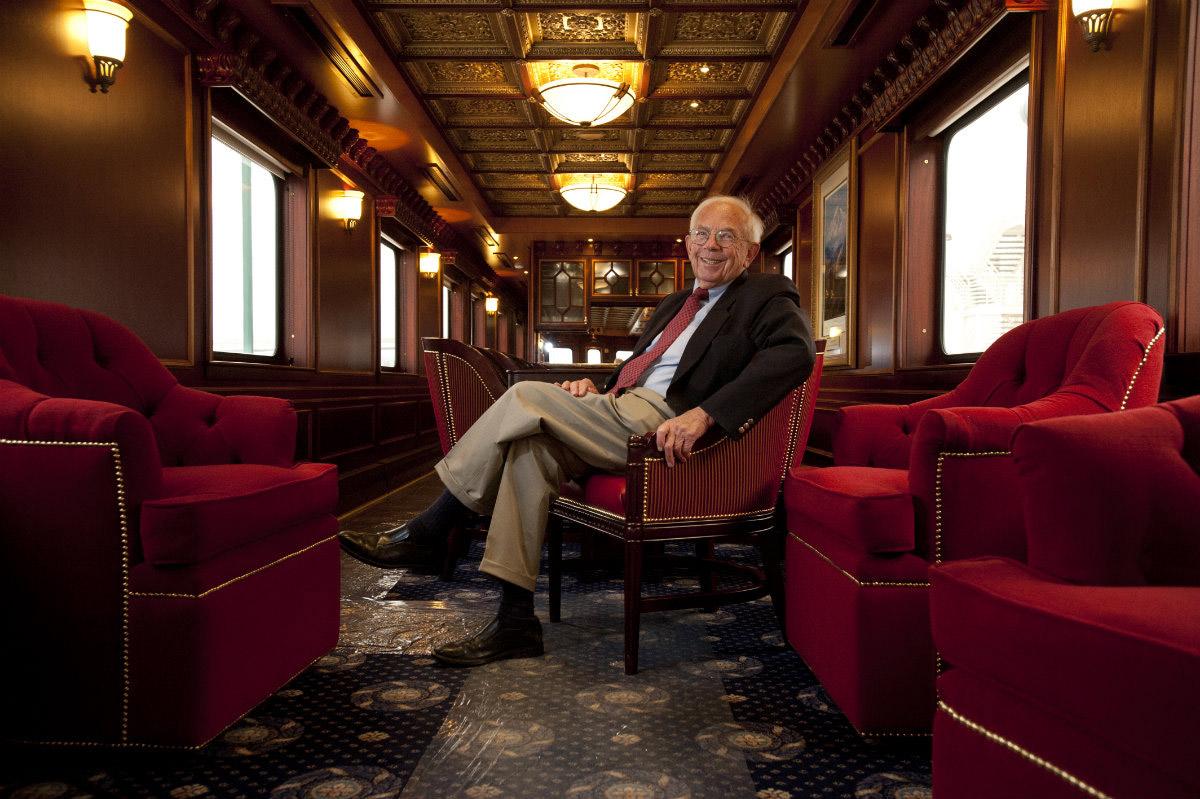 Business Portrait of former governor Bill Sheffield in a restored Alaska Railroad car.