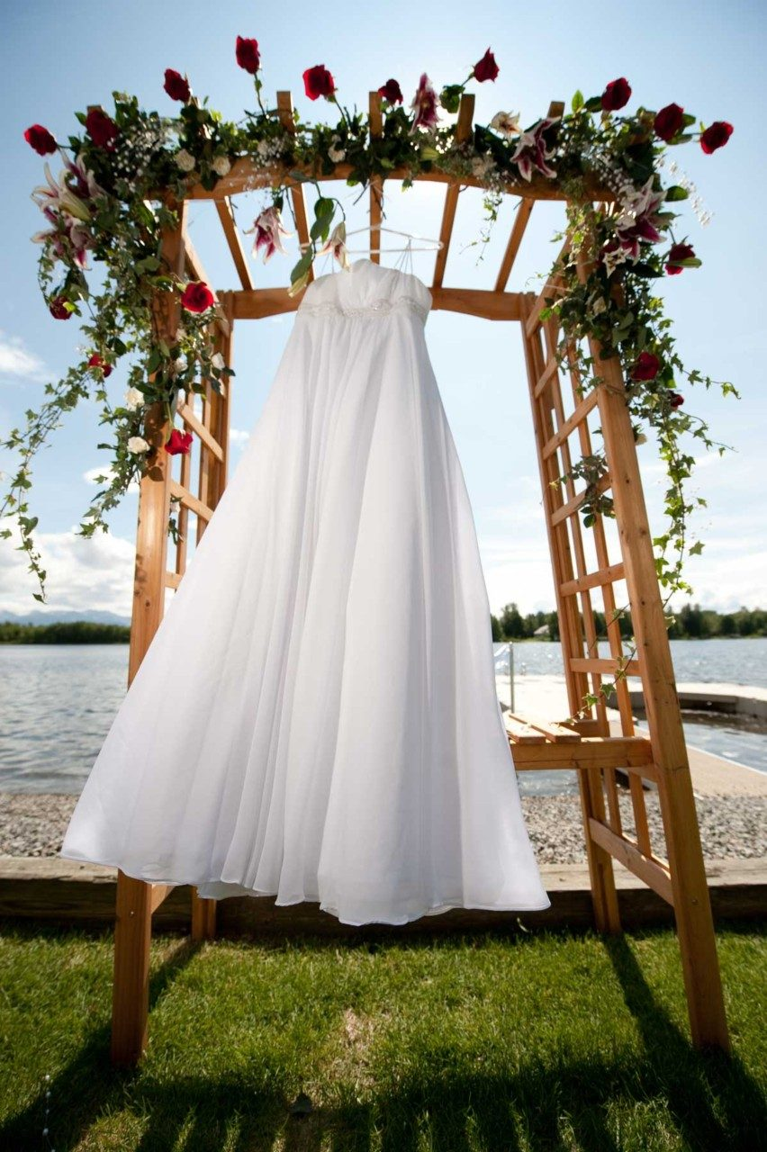 Lena Amor's wedding dress flutters above her lakeside venue.