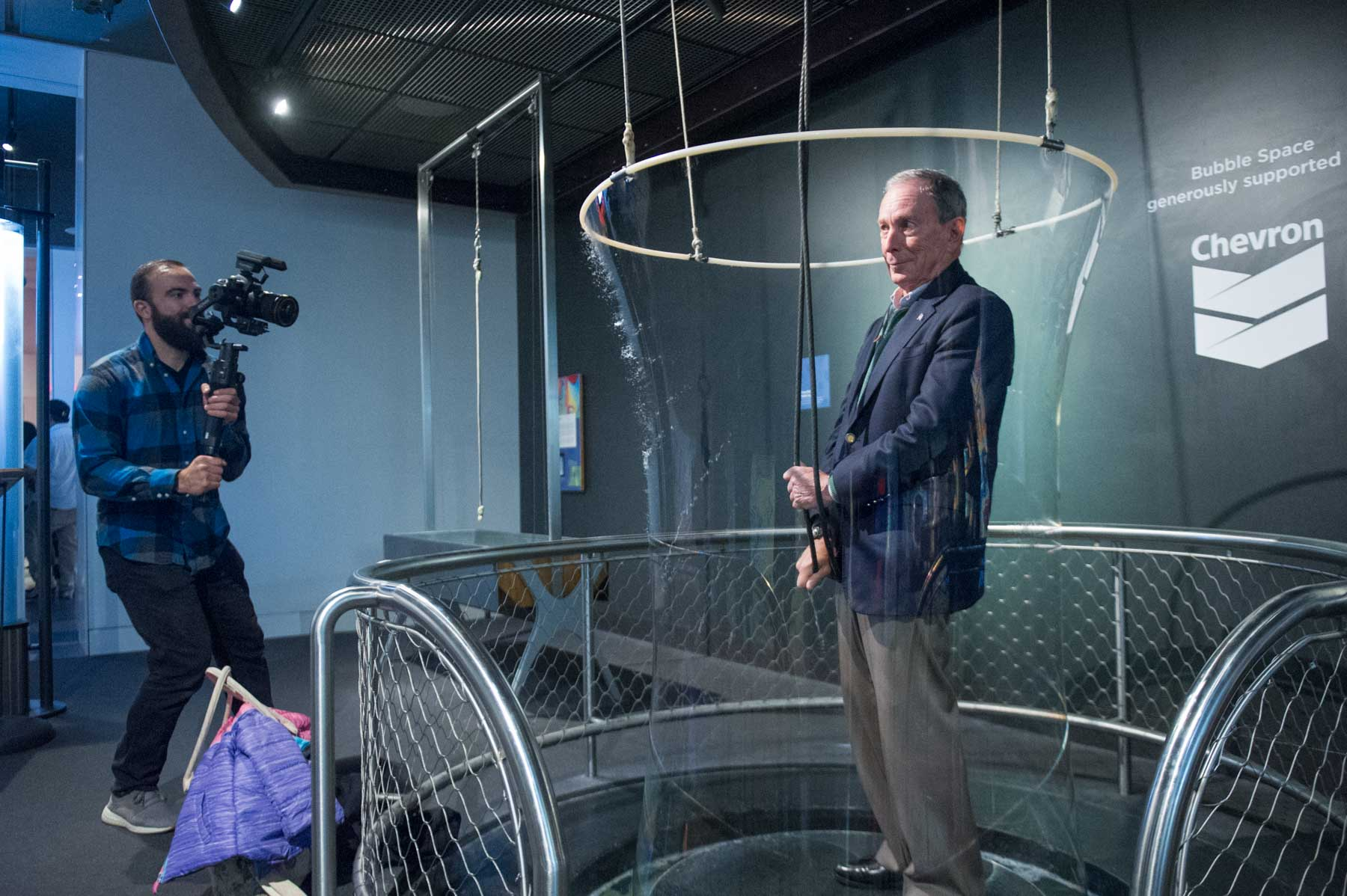 Michael Bloomberg tries out a life-size bubble machine at the Anchorage Museum.