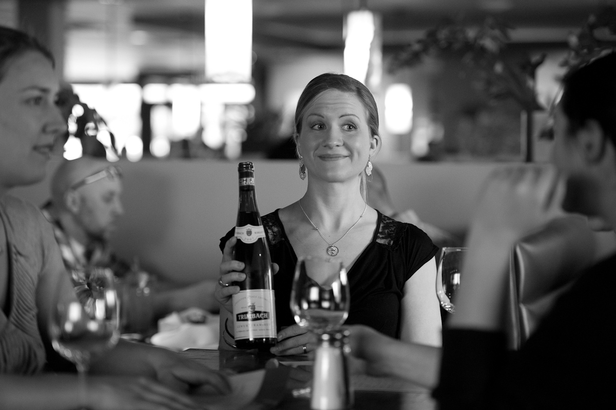 A server offers a wine selection at Suite 100 in Anchorage.