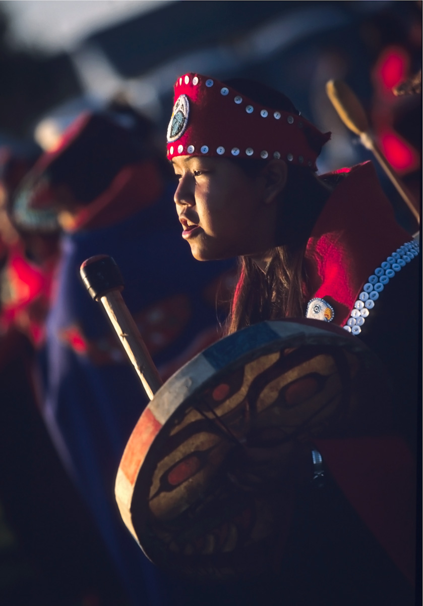 Tlingit dancer Crystal Tyone drums in an outdoor ceremony in Anchorage.