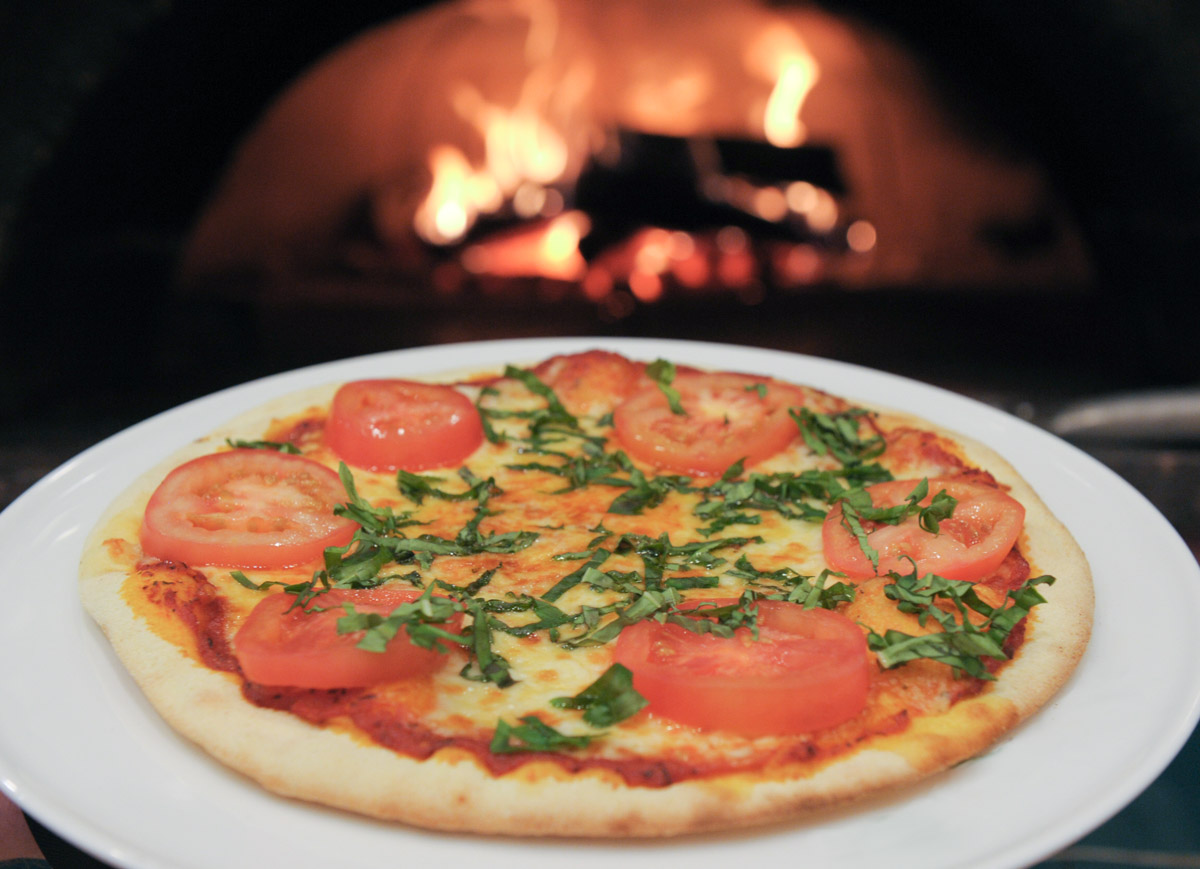 A wood-fired pizza comes out of the oven at SouthSide Bistro.