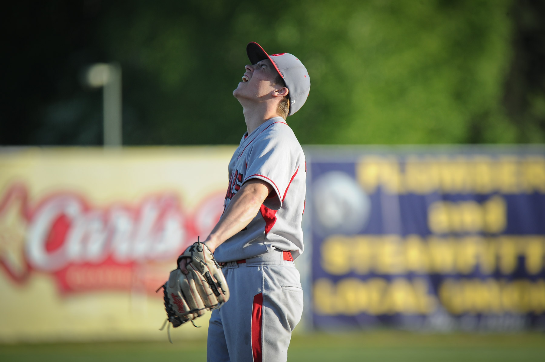 Juneau pitcher Donavin McCurley expresses the anguish of a 12-2 loss to South.