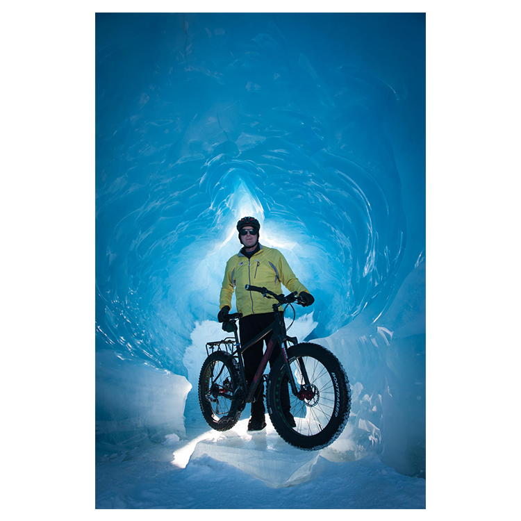 Spencer Glacier provides a dramatic background for this fatbiking photo