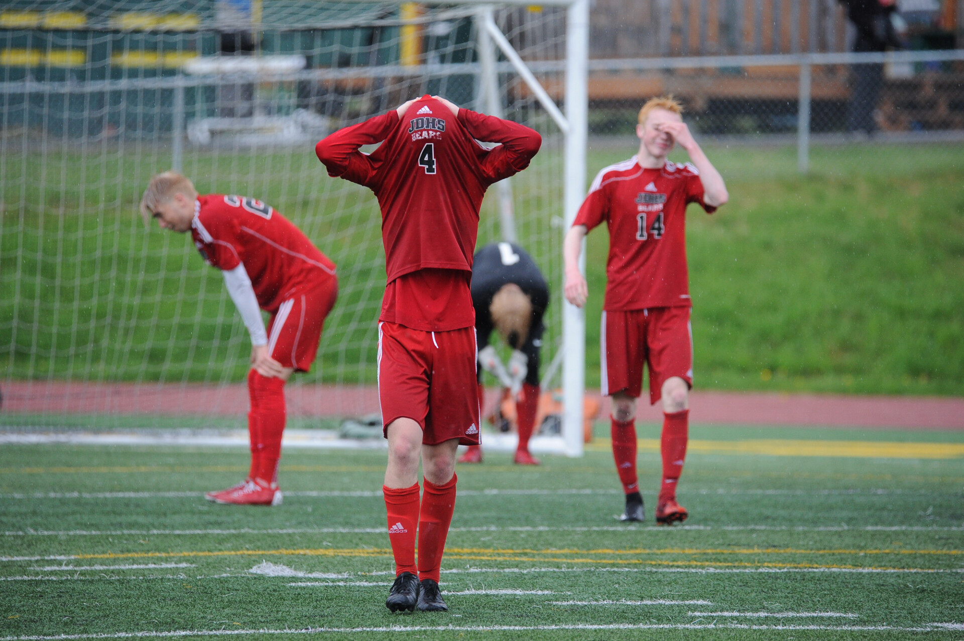Juneau's soccer team reacts to their state-chamionship loss.